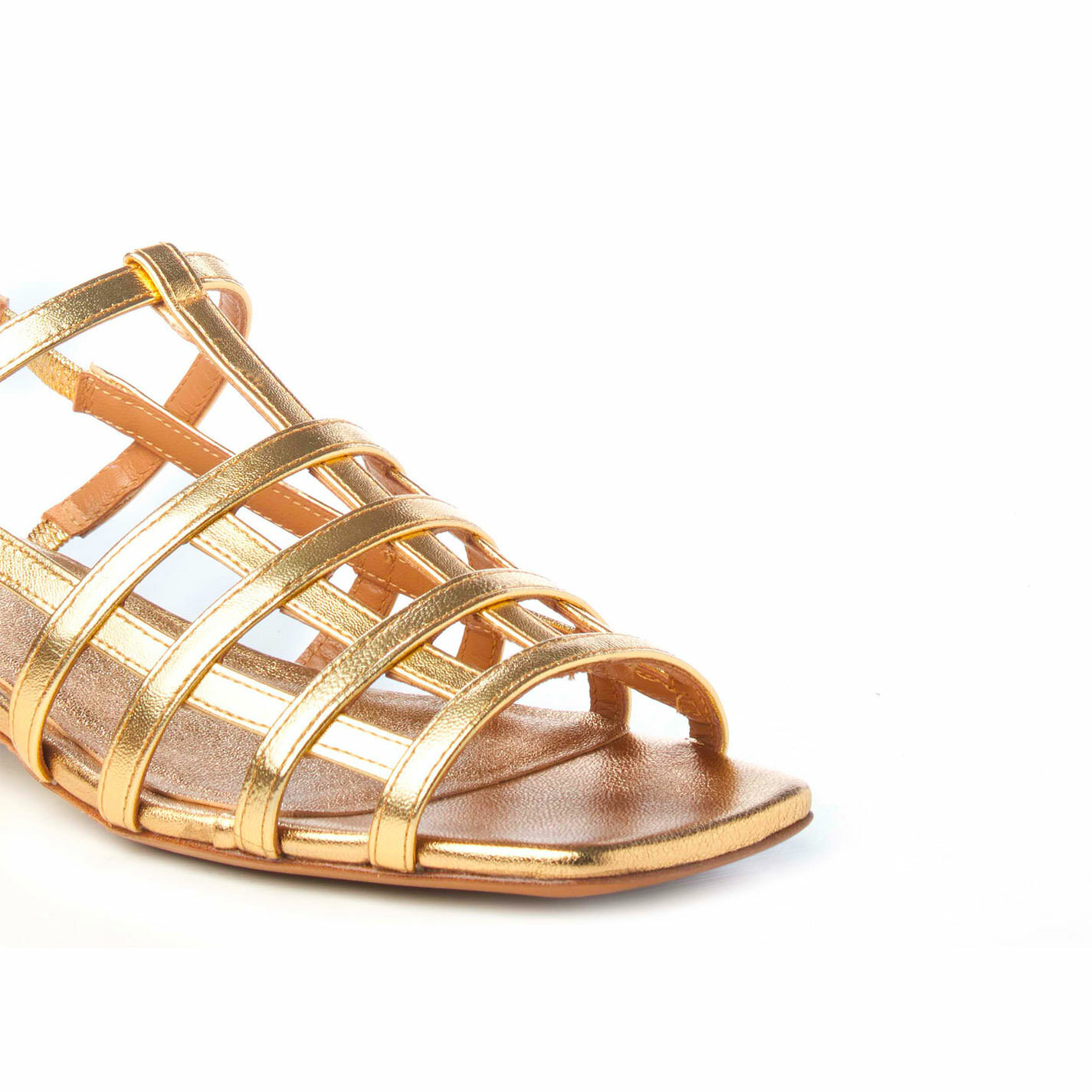 Flat cage sandals in laminated golden nappa leather