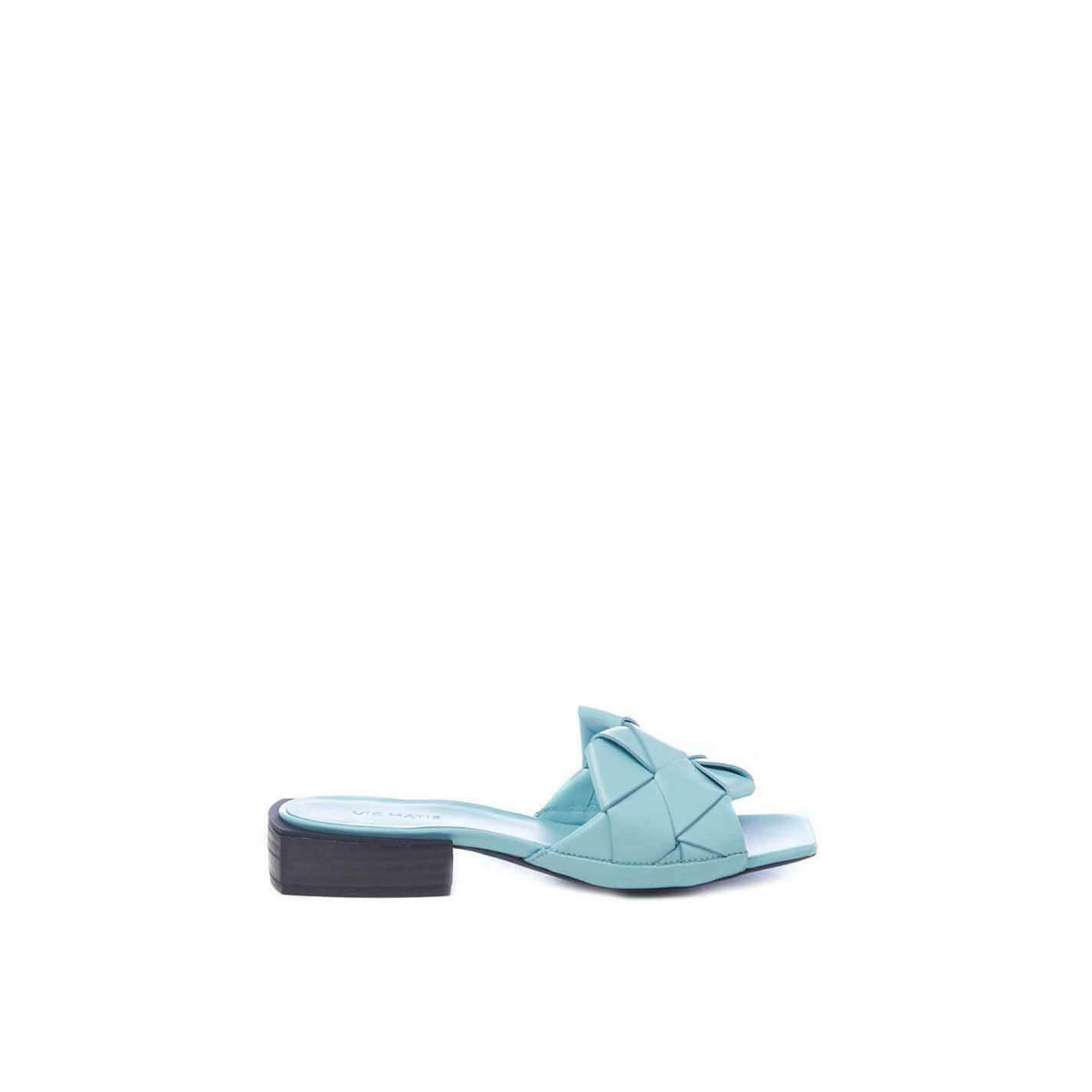 Flat sky-blue calfskin slip-ons