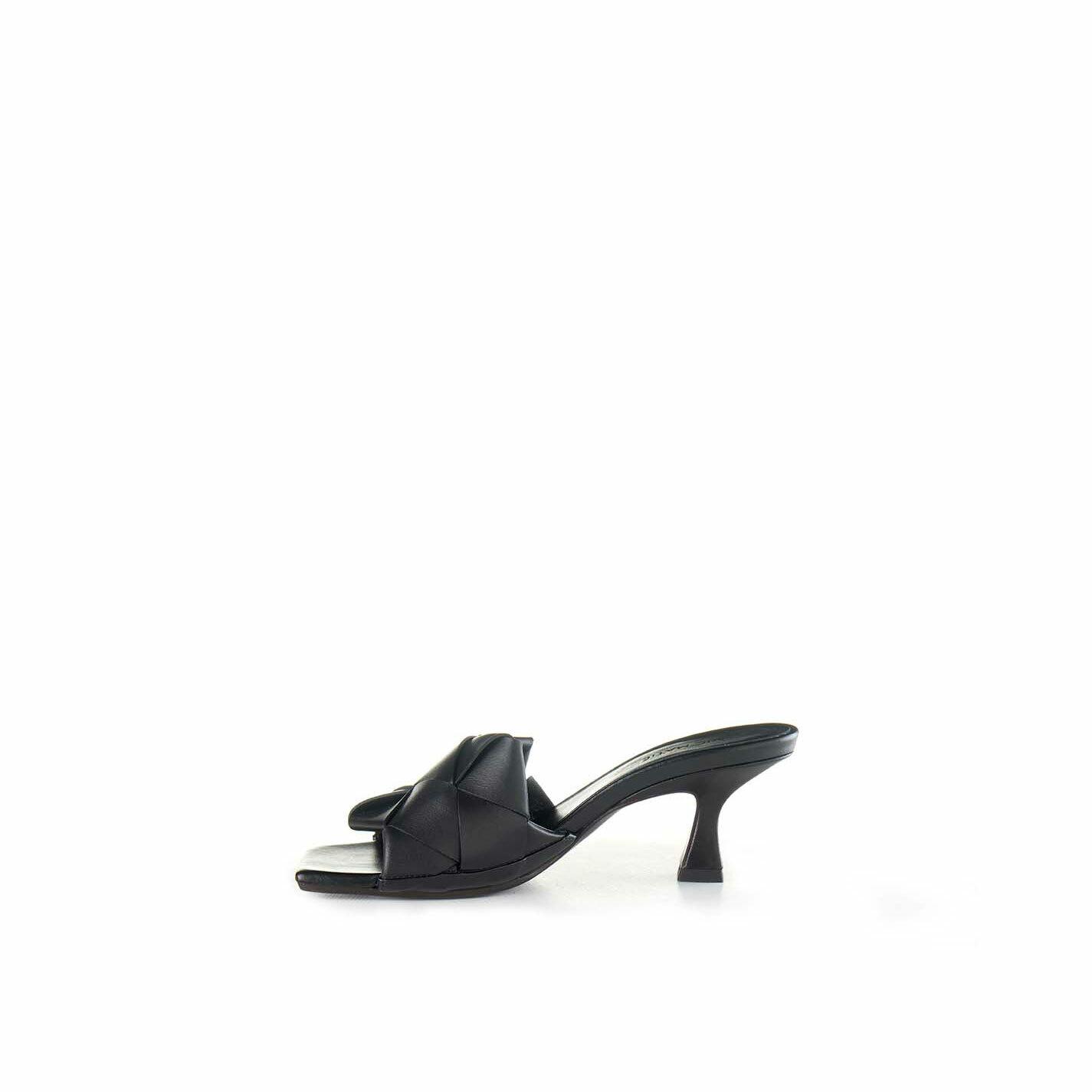 Black slip-ons with spool heel
