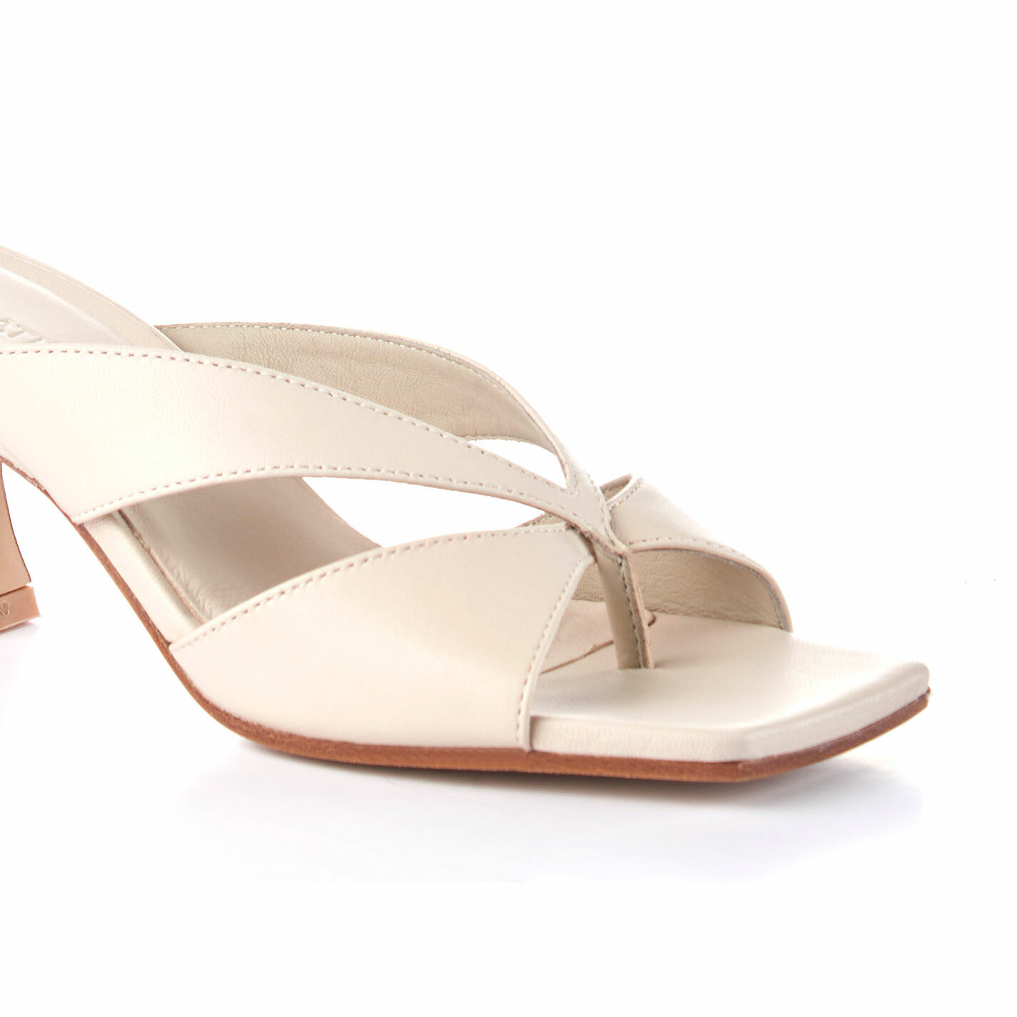 Ivory-coloured sandals with spool heel