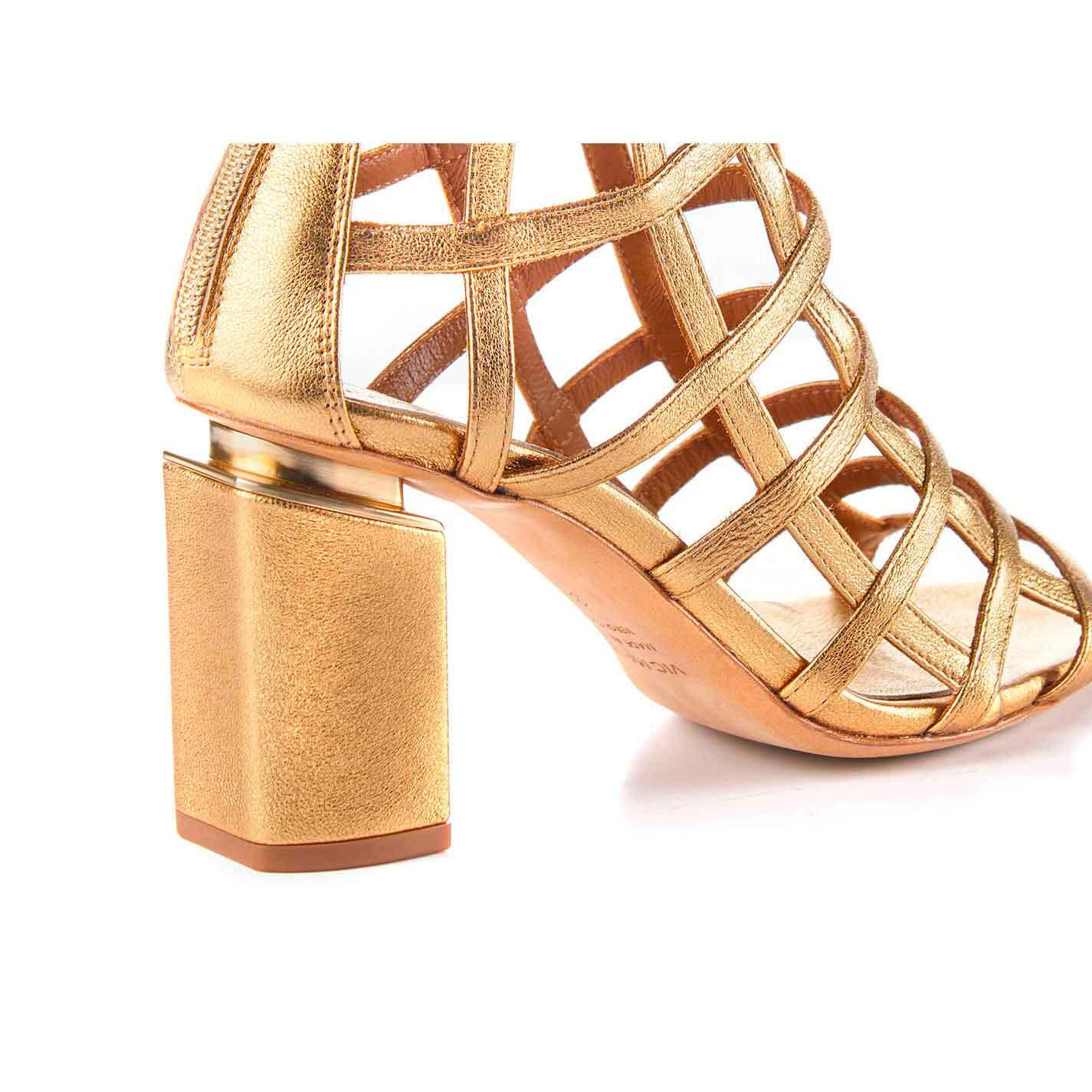 Golden cage-effect ankle boots with suspended heel