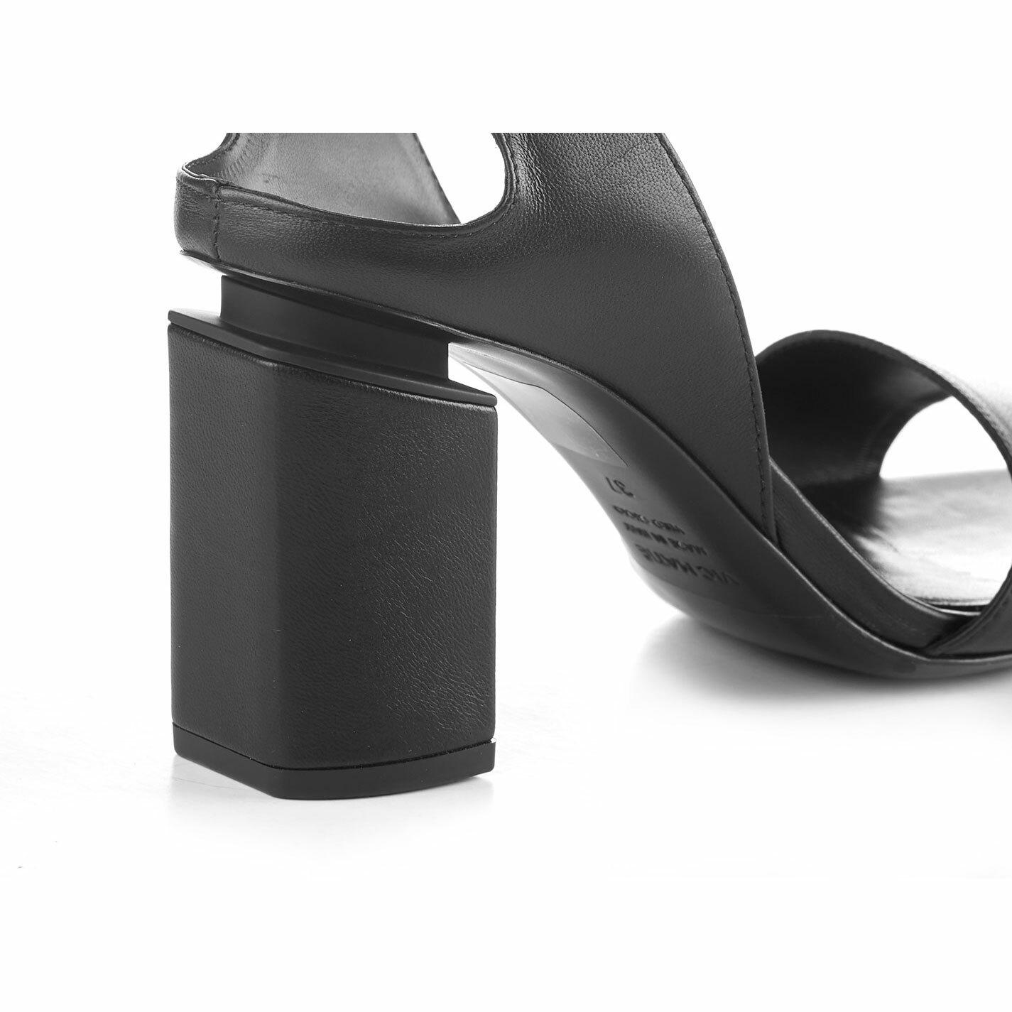 Black sandals with suspended heel